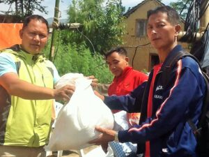 BCM Nepal director Robbin Vaidhya distributing aid